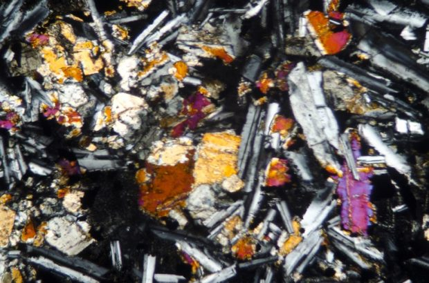 Augite in Bingfield dyke basalt. Sample viewed in with crossed polarising filters at x25.
