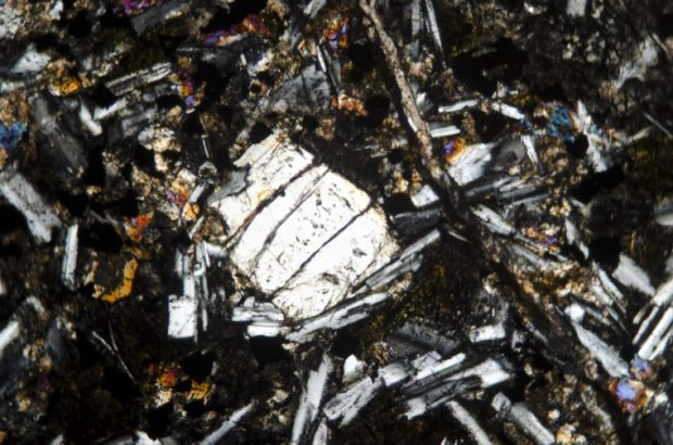 Orthopyroxene in Bingfield dyke basalt. Sample viewed in with crossed polarising filters at x25.