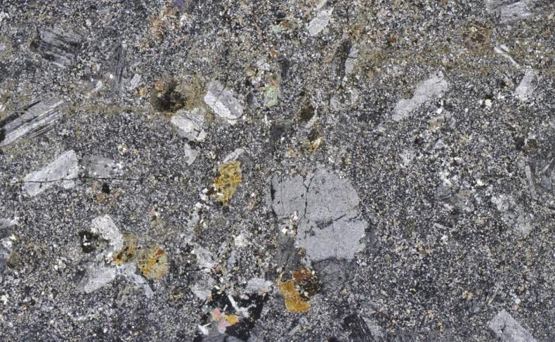 Fine-grained Marginal quartz monzonite at Location 2, Dunmoor Hill viewed with crossed polarising filters.