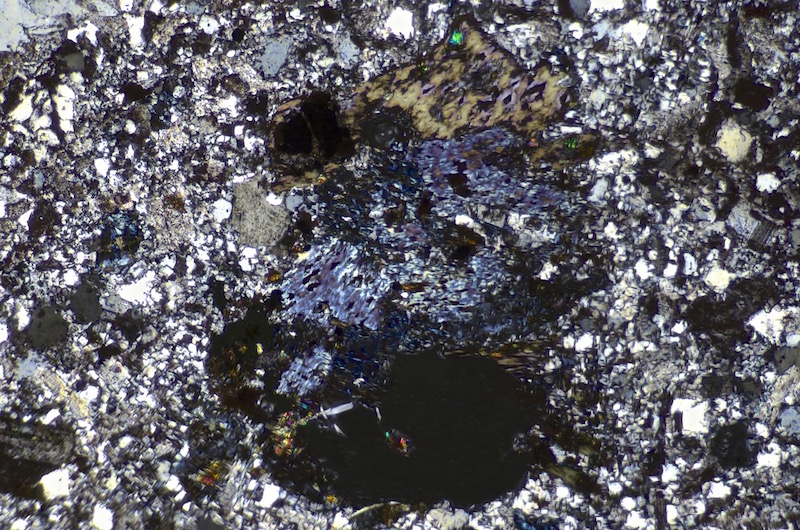 Thin section of felsite dyke, Linhope Spout viewed with crossed polarising filters