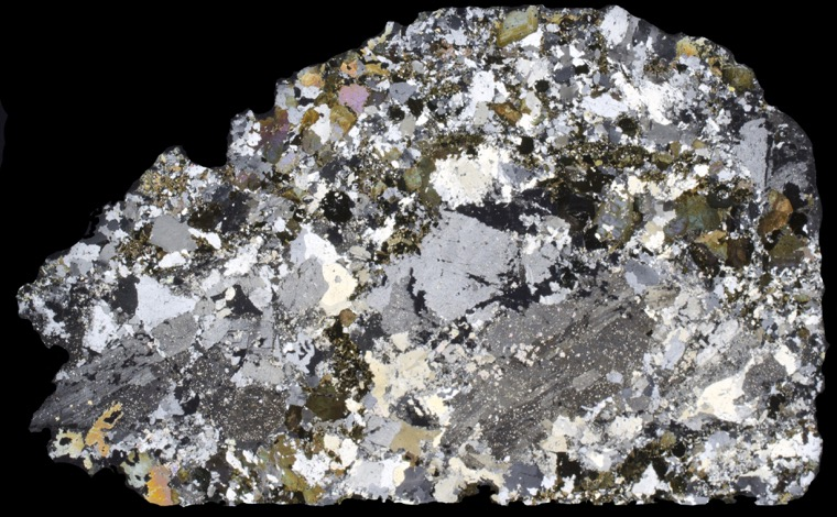 Altered porphyritic rock from the summit of Hedgehope Hill. Thin section viewed with crossed polarising filters.