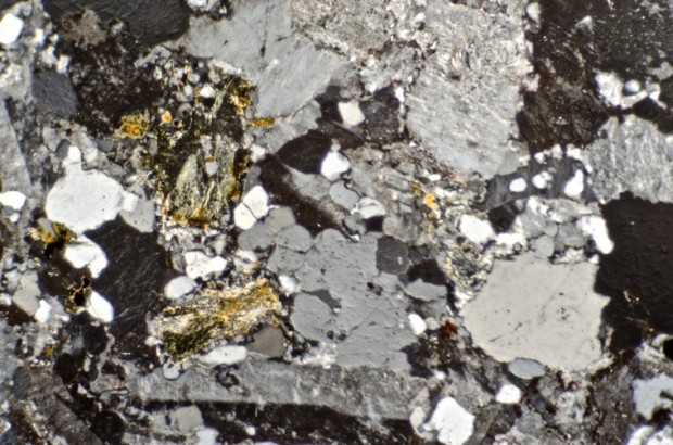 Altered biotite in quartz-porphyry dyke, location 5 Hedgehope Hill viewed with crossed polarising filters