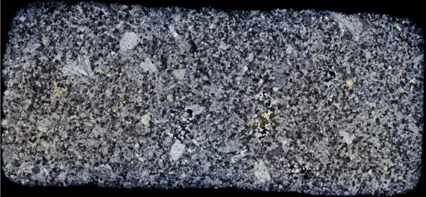 Highly altered rock at Location 2 showing blotchy appearance and very dark patches of tourmaline. Thin section viewed with crossed polarising filters.
