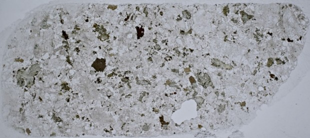 Thin section of   syeno-granite  at location 4 viewed in plane polarised light.