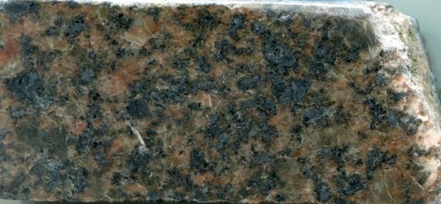 Syeno-granite   at location 4. Prepared hand specimen in reflected light.