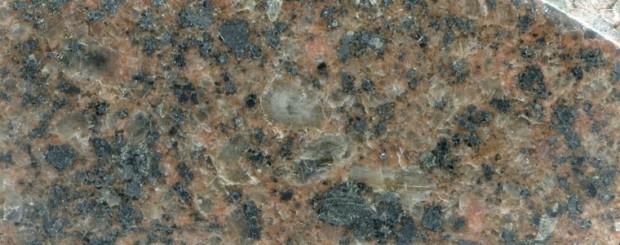 Syeno-granite   at location 5 Harthope Linn. Prepared hand specimen in reflected light.
