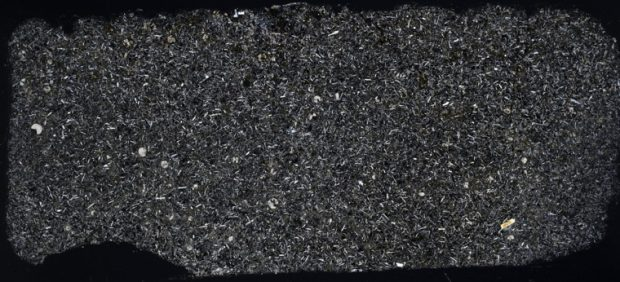 Thin section of tholeiitic basalt from the Hartley South Dyke viewed with crossed polarising filters.