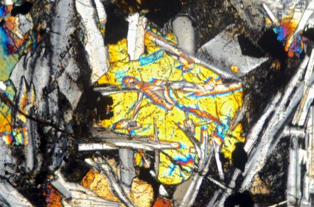 Twinned pyroxene in Kielderhead tholeiite basalt viewed in vertical position with crossed polarising filters X25