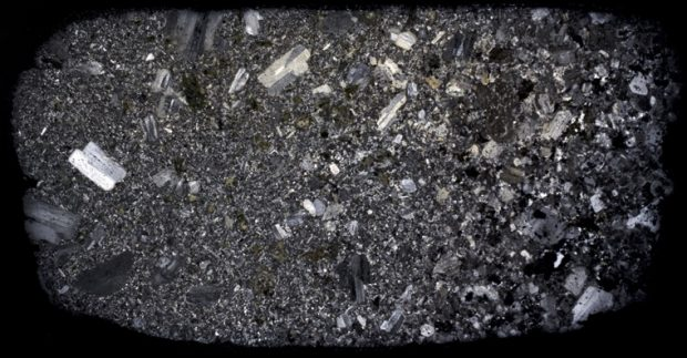 Syeno-granite   (right) in contact with an andesitic xenolith (left)