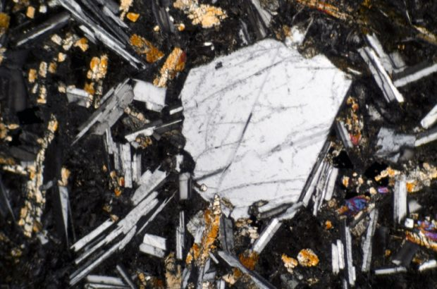 The same plagioclase phenocryst viewed with crossed polarising filters