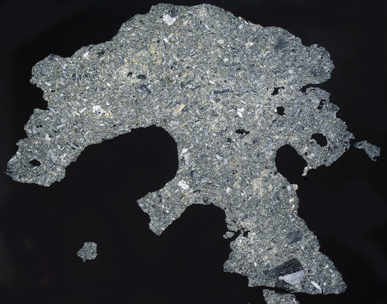 Andesite hornfels (S.G. 2.84) Dunmoor Hill. Thin section viewed with crossed polarising filters (Section measures 20 mm across)