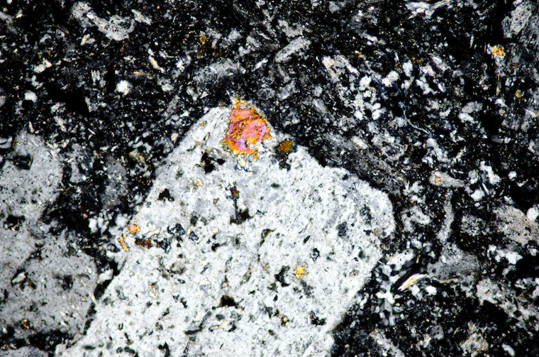 Pyroxene inclusions in plagioclase viewed with crossed polarising filters (FoV 1.3 x 0.8 mm)