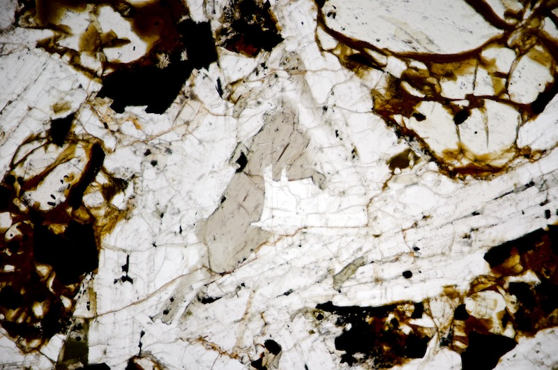 Plagioclase, pyroxene, olivine and opaques Section viewed in plane polarised light (FoV 2.3 x 1.5 mm)