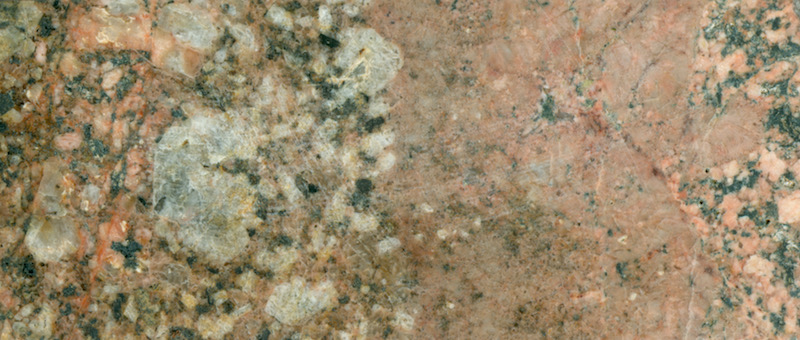 Contact between coarser- and finer-grained granitic rock on Shielcleugh Edge( NT918166) Prepared hand specimen in ordinary reflected light (48mm across)