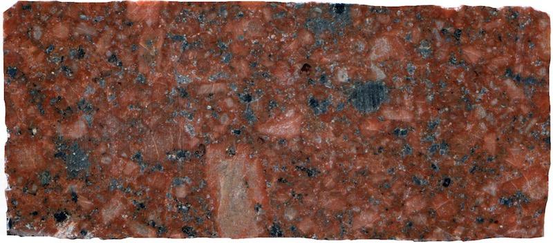 Quartz-porphyry dyke at Low Bleakhope. Prepared hand specimen in ordinary reflected light (40mm across)