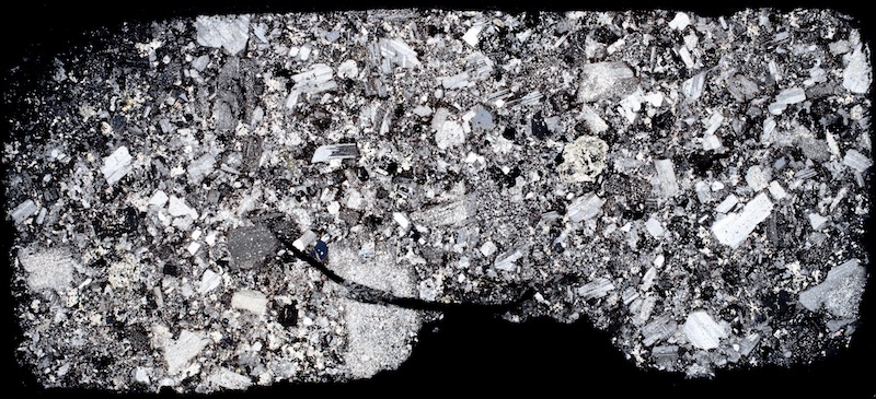 Quartz-porphyry dyke at Low Bleakhope. Thin section viewed with crossed polarising filters. (40mm across)