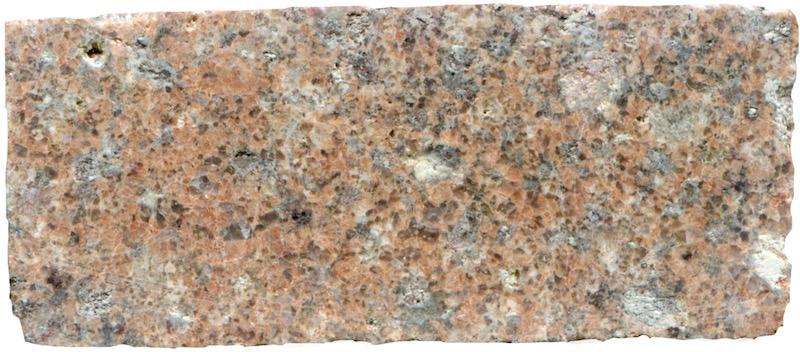 High quartz and alkali feldspar granite  below Low Bleakhope. Prepared hand specimen in reflected light (45mm across)