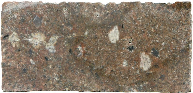 Medium-grained sub-equigranular granite , Hawsen Burn NT951227. Prepared hand specimen viewed in ordinary reflected light