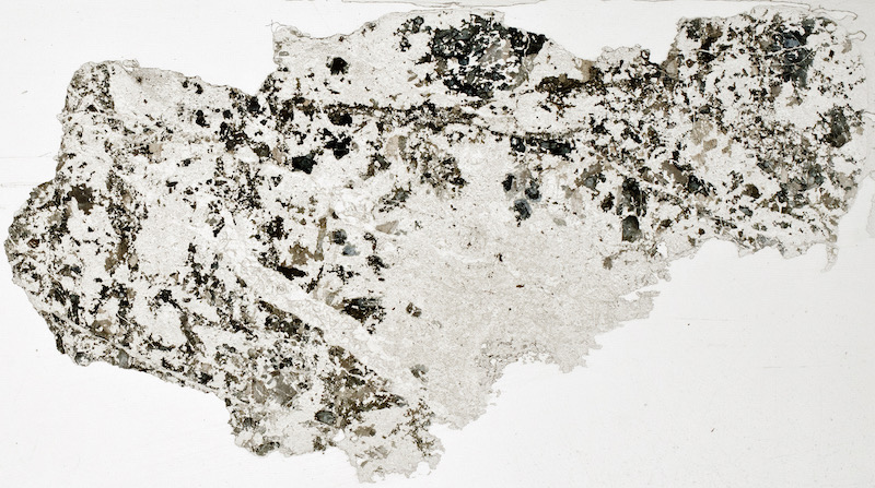 Tourmaline in silica vein, Hawsen Burn. Thin section viewed in plane polarised light (28 mm across)