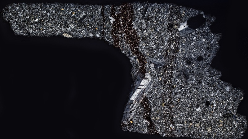 Andesite, Brough Law NT995162. Thin section viewed with crossed polarising filters (35mm across)