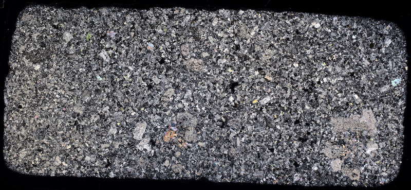 Porphyry, west of Hawsen Burn NT950226. Thin section viewed with crossed polarising filters (48mm across)