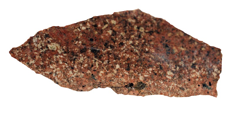 Granite, Woolhope Crag NT922221. Prepared hand specimen in ordinary reflected light (36mm across)