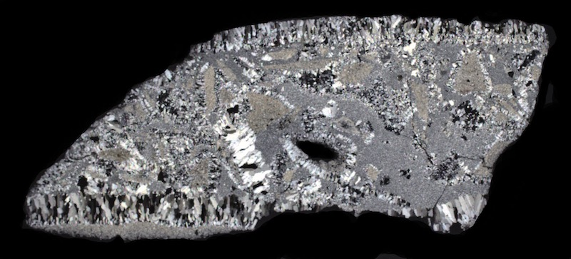 Quartz vein with rock fragments in granite, Cheviot NT921210. Thin section viewed with crossed polarising filters (40mm across)