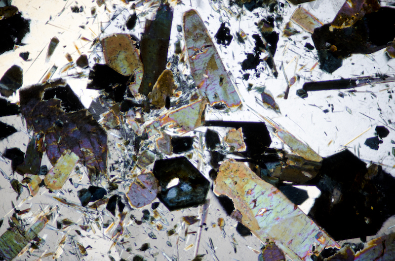 Tourmaline with quartz. Section viewed with crossed polarising filters (FoV 4.6 x 3.0 mm)