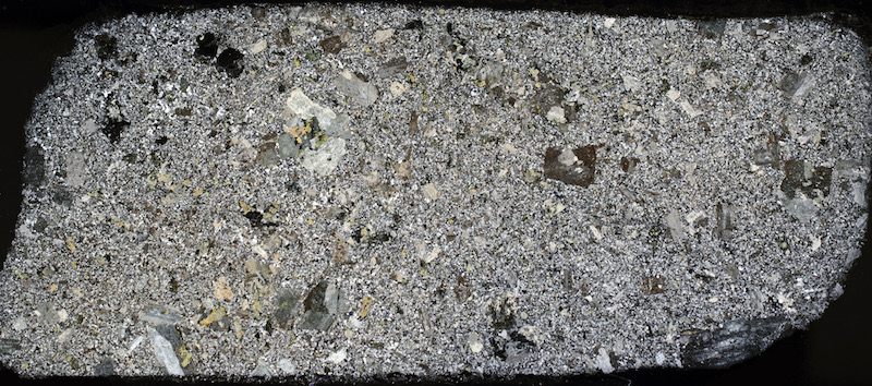 Fine-grained porphyritic granitic rock, Cheviot NT919210. Thin section viewed with crossed polarising filters (48mm across)