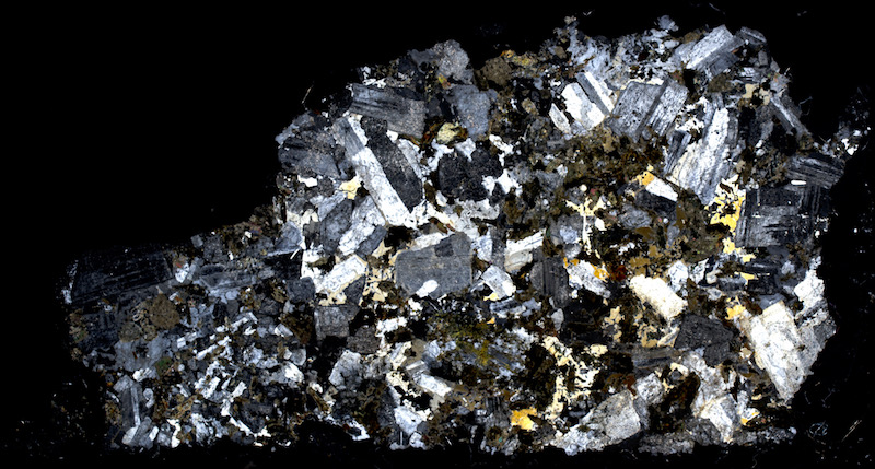 Altered Central Belt granitic rock. Thin section viewed with crossed polarising filters (20mm across)