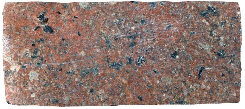 Sub-equigranular granite, Cheviot. Prepared hand specimen in ordinary reflected light (46mm across)