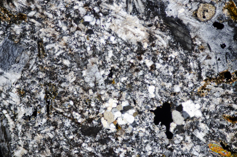 Area of quartz in the groundmass. Section viewed with crossed polarising filters (FoV 2.3 x 1.5 mm)