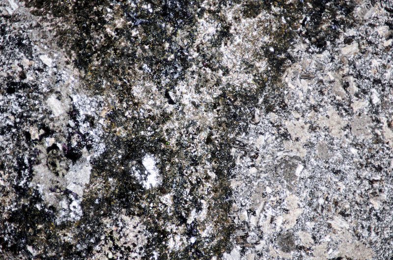 Chloritic, very mafic intrusion into carbonatised andesite. Section viewed with crossed polarising filters (FoV 4.6 x 3.0 mm)