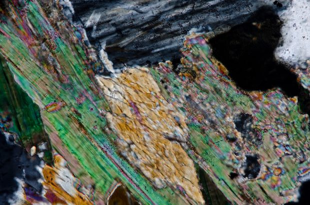 Amphibole, biotite and chlorite in Central Belt granitic rock. Section viewed with crossed polarising filters.