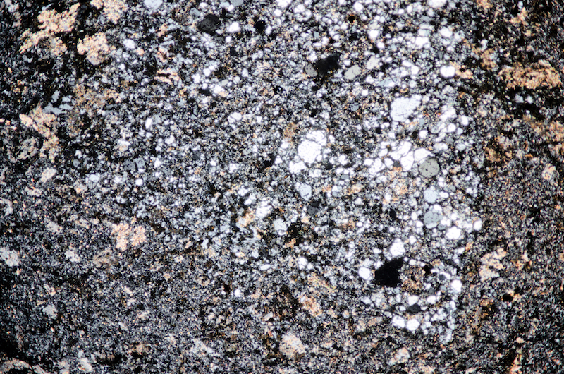Angular patch of small anhedral quartz grains in carbonatised andesite. Section viewed with crossed polarising filters (FoV 4.6 x 3.0 mm)