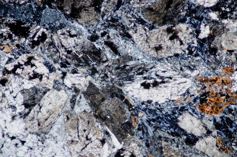 Mafic material in the sample from Low Bleakhope. Section viewed with crossed polarising filters (FoV 1.2 x 0.8 mm)