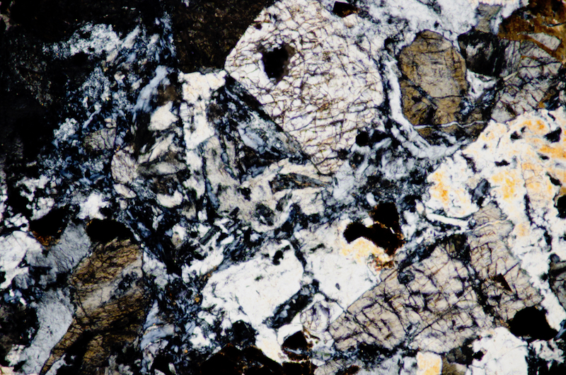 Pyroxenes in the sample.  Section viewed with crossed polarising filters (FoV 1.2 x 0.8 mm)