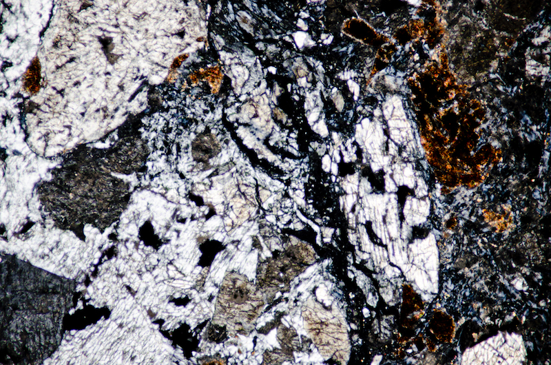 Pyroxenes in the same sample. Section viewed with crossed polarising filters (FoV 1.2 x 0.8mm)