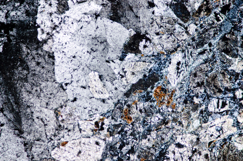 Quartz and mafic material. Section viewed with crossed polarising filters (FoV 2.3 x 1.5 mm)