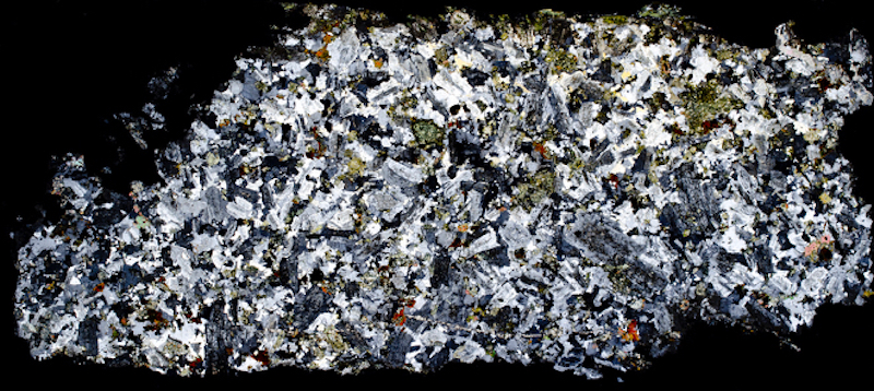Marginal quartz-monzonite at waterfall on Ainsey Burn. Thin section viewed with crossed polarising filters (48mm across)