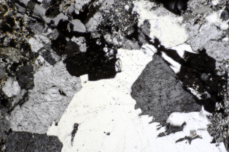 Quartz and feldspar in intensively altered rock, Harthope Valley NT912190. Section viewed with crossed polarising filters (FoV 1.3 x 0.8 mm)