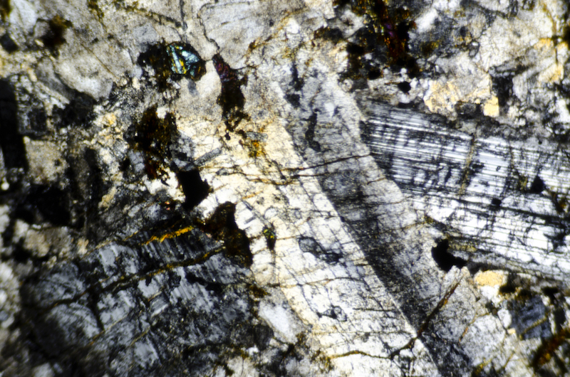 Plagioclase phenocrysts in altered Central Belt rock. Section viewed with crossed polarising filters (FoV 1.2 x 0.8 mm)