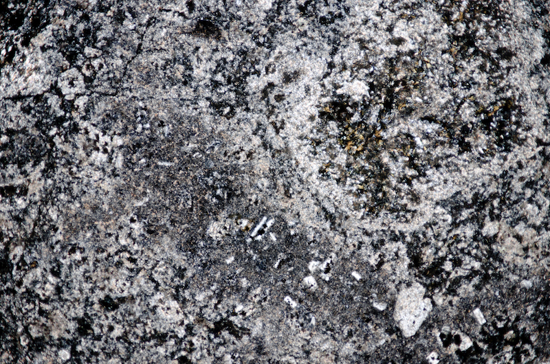 Carbonatised and chloritised andesite or tuff. Section viewed with crossed polarising filters (FoV 4.6 x 3.0 mm)