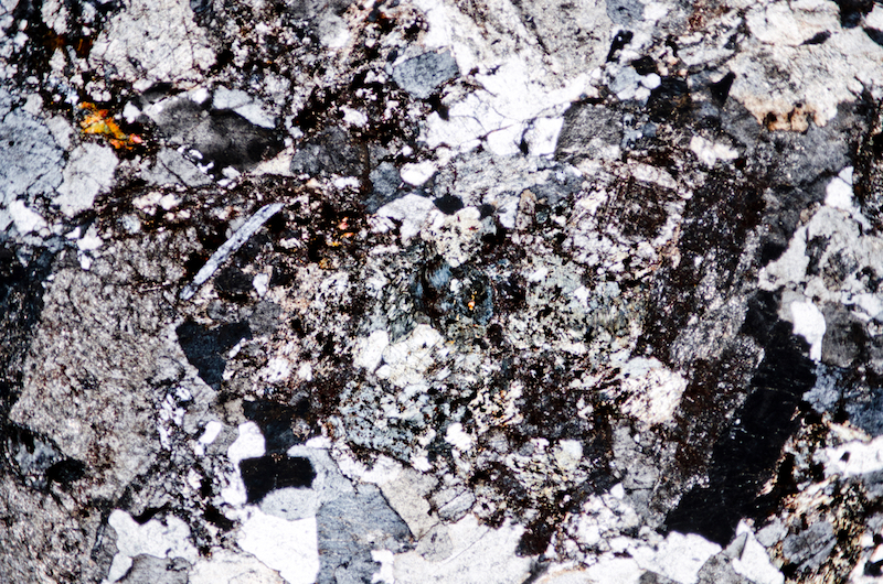 Alteration in Marginal quartz monzonite. Section viewed with crossed polarising filters (FoV 4.6 x 3.0 mm)
