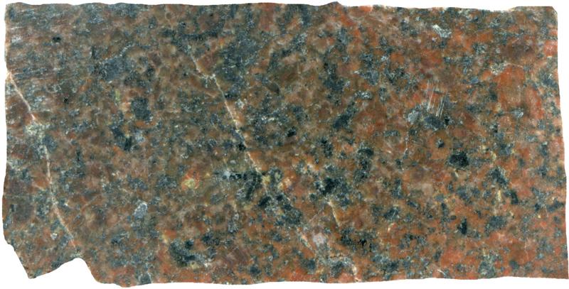 Sub-equigranular granite. Low Bleakhope NT940160. Prepared sample viewed in plain reflected light (39mm across)